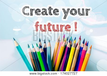 Create your future, text message on blue background with color pencil