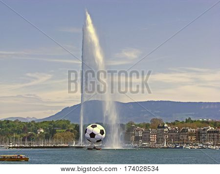 The famous water jet fountain (Jet d'eau) in Geneva, Switzerland. Soccer ball represents the 2008 UEFA Championships hosted in Geneva. The plume of water is 140m tall. Built in 1886.