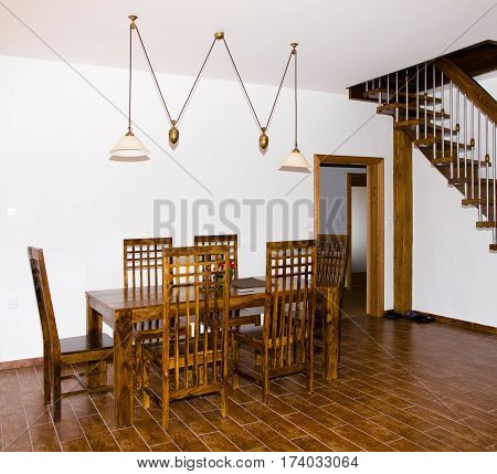 Interior of new dinning room with wooden table and chairs
