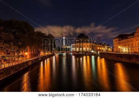 night view of the Museumsinsel in Berlin with the Berlin Cathedral the Television Tower and reflections in the river Spree