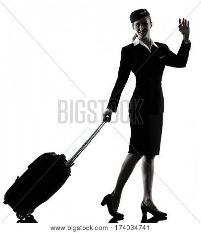 one caucasian Stewardess cabin crew  woman Saluting isolated on white background in  silhouette