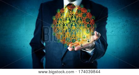 Male business professional showing a virtual globe representing global network connections in the open palm of his left hand. Business concept for worldwide networking and communication technology.