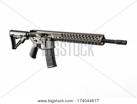 An Assult Rifle with a white background