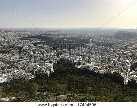 ATHENS - FEBRUARY 28, 2017: View to the South-West over the urban city sprawl from atop Mount Lycabettus in Athens, Greece.