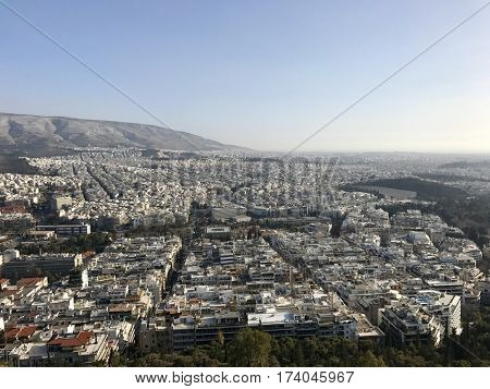 ATHENS - FEBRUARY 28, 2017: View to the South over the urban city sprawl from atop Mount Lycabettus in Athens, Greece.