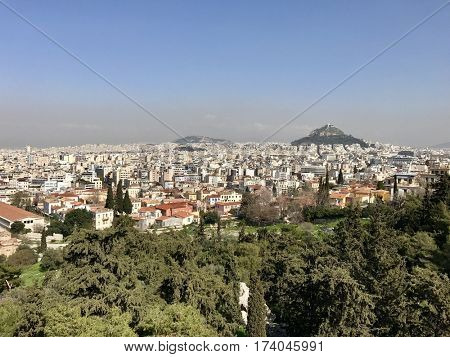 ATHENS - FEBRUARY 28, 2017: The sprawling urban expanse of city blocks viewed from Areopagus Hill, also know as Mars Hill, in central Athens, Greece.