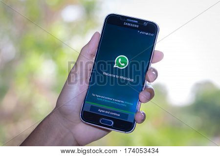Chiang Mai,Thailand - March 2, 2017: Smartphone Samsung Galaxy S6 open apps whatsapp application on the screen on the desk.