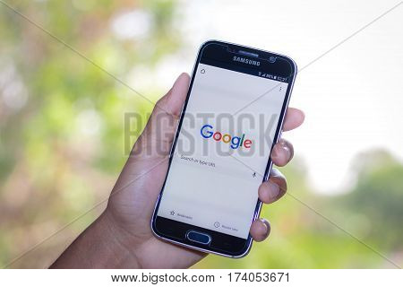 Chiang Mai,Thailand - March 2, 2017: Smartphone Samsung Galaxy S6 open apps google search application on the screen on the desk.