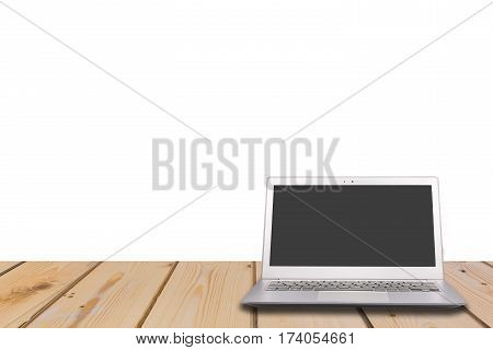 Laptop with blank screen on wooden table with white background can used for display or montage your products