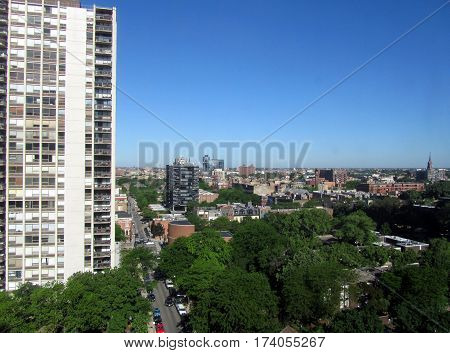 Aerial View of Chicago neighborhoods in the early morning in summer time under a clear blue sky
