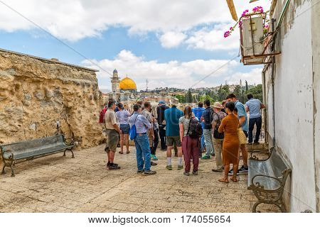 JERUSALEM, ISRAEL - MAY 23, 2016: Group of tourist sightseeing the Western Wall, located in the Old City at the foot of the western side of the Temple Mount.