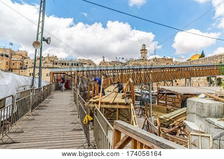 JERUSALEM, ISRAEL - MAY 23, 2016: The workers are building a wooden ramp at the Mughrabi Bridge, wooden bridge connecting the Western Wall plaza with the Mughrabi Gate of the Temple Mount in old city.