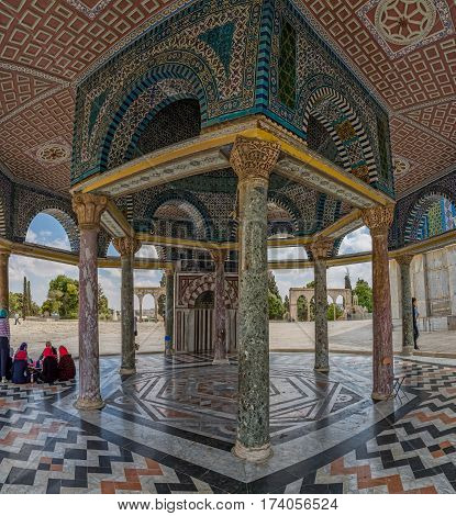 JERUSALEM, ISRAEL - MAY 23, 2016: Women talking in the shade of the Dome of the Chain on east side of the Dome of the Rock, an Islamic shrine located on the Temple Mount in the Old City.