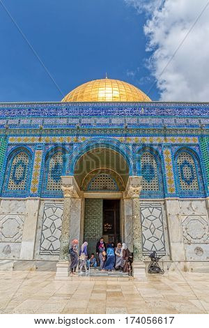 JERUSALEM, ISRAEL - MAY 23, 2016: Visitors at the entrance of the Dome of the Rock is an Islamic shrine located on the Temple Mount in the Old City.