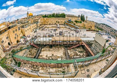 JERUSALEM, ISRAEL - MAY 23, 2016: Fisheye view of the prayers making their wishes and prays at the Western Wall, located in the Old City at the foot of the western side of the Temple Mount.