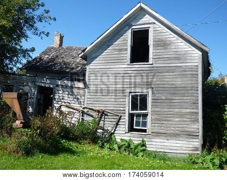 And abandoned rural farm house on a old farmstead