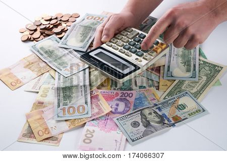 Accounting finance concept. Businessman or accountant using calculator with accounting report and financial statement and money.