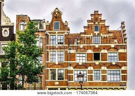 Bell Gables and Step Gables of Historic Houses along the canals of in Amsterdam, the Netherlands