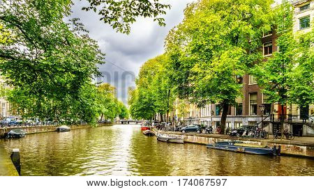 Typical Canal Scene with Historic Canal Houses in Amsterdam, the Netherlands