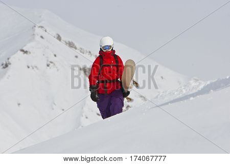 Freerider with the snowboard in the mountains of Georgia