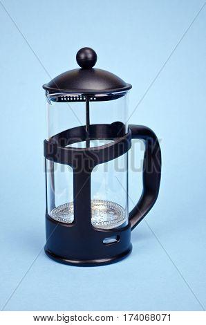 new black teapot on blue azure background