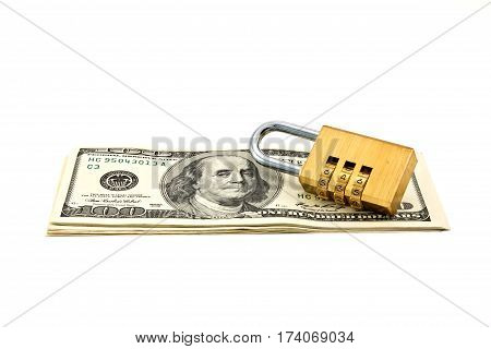 A combination pad lock shot over stack of Dollars banknotes
