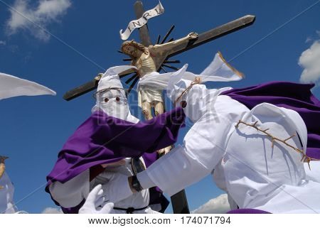 VILLAROSA ITALY - March 21 2008: Holy Week in Sicily. The hooded carry in procession the statue of Christ and the cross in the representation of the passion and death of Jesus.