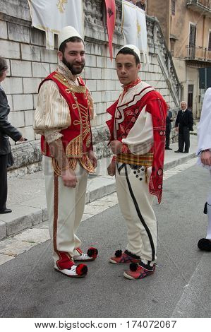 PIANA DEGLI ALBANESI ITALY - April 20 2014: Holy Week in Sicily. Easter procession of women and men greek byzantine rite dressed in the traditional costumes of the Albanian '400.