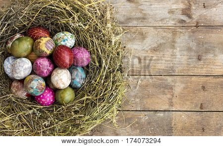 Colorful painted and decorated Easter eggs in a nest of hay