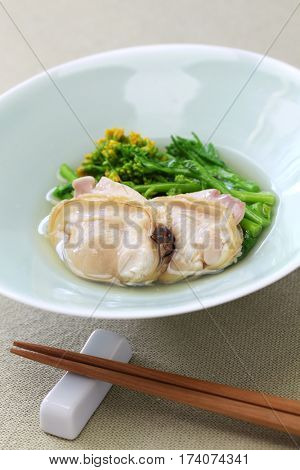 steamed hamaguri clams and field mustard in rice wine, japanese cuisine
