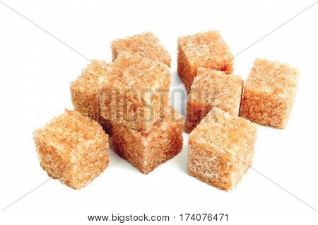 Lump brown cane sugar cubes isolated on white background.