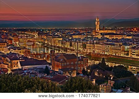 Florence, Tuscany, Italy: view at twilight of the city from Piazzale Michelangelo - landscape of the town and the Arno river with the old bridges