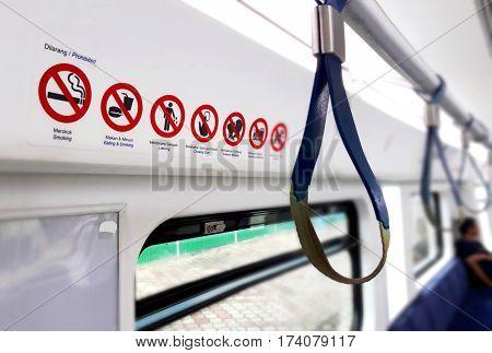 Train interior reminder signage in close up