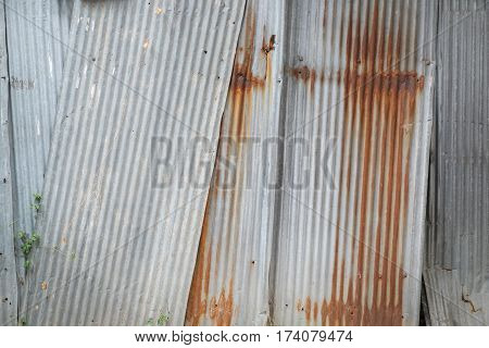 Old metal sheet roof texture. Pattern of old metal sheet. Metal sheet texture. Rusty metal sheet texture.