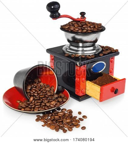 Old antique wooden coffee grinder. Coffee mill hand-painted in black red and blue. Next to the mill black and red cup and spilled coffee beans. The whole composition isolated on white background with light shadow and reflection.