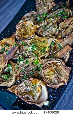 artichokes baked in oven seasoned only with olive oil parsley and lemon are a healthy and purifying food to stay fit during the summer