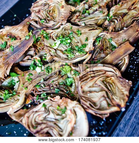 artichokes baked in oven seasoned only with extra virgin olive oil parsley and lemon are a healthy and purifying food to stay fit during the summer
