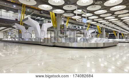 International airport baggage belt claim area. Nobody. Travel background. Horizontal