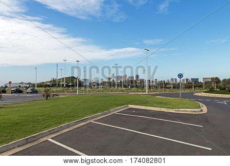 Empty Larking Bays And Green Grass Lawn On Beachfront