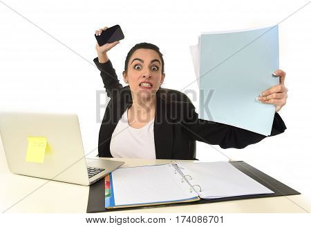 busy attractive woman in business suit working in stress desperate overwhelmed and overworked in office computer desk looking sad and depressed isolated on white background