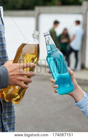 Close Up Of Teenage Group Drinking Alcohol