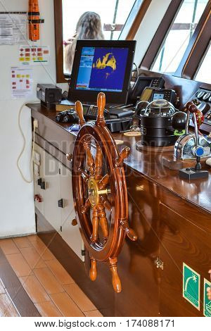 The steering wheel and navigation instruments in the cockpit of the ship