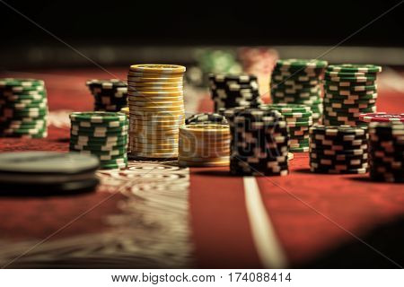 Close-up view of poker chips on poker table at casino