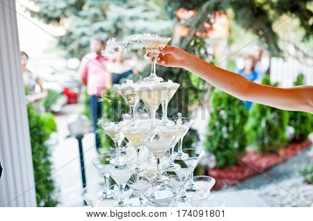 beautiful pyramid of champagne glasses at a wedding