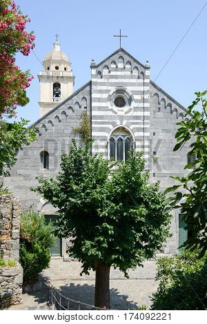 Portovenere Italy - 7 July 2015: The Romanesque church of St. Lawrence (erected in 1098 restored in 1582). Portovenere town (UNESCO world heritage site) Liguria Italy
