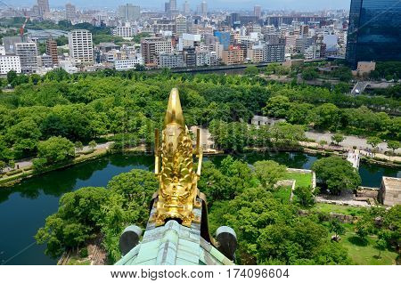 Golden Dragon Fish Statue Or Shachihoko At Roof Top And Aerial View Around Osaka Castle