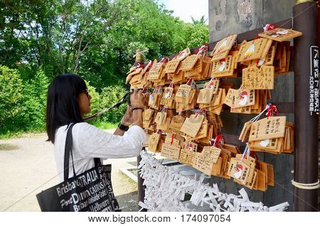 Traveler Thai Woman Looking And Shooting Photo Ema Wood Tag Or Wooden Label For Pray