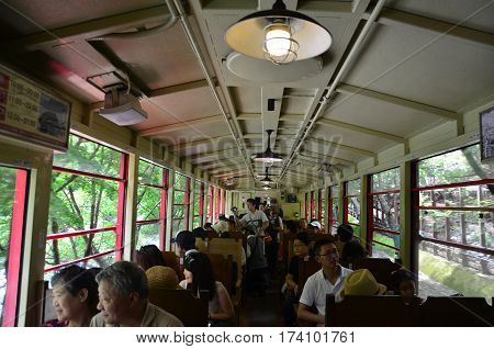 Japanese People And Traveler Foreigner Tour On Sagano Scenic Railway For Looking View Of Hozugawa Ri