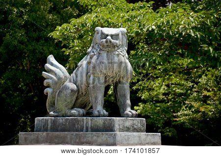 Lion Guardian Statue At Hokoku Shrine In Osaka Castle Park