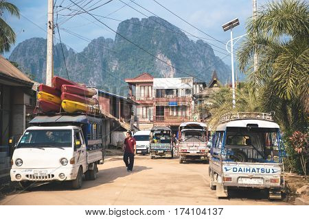 Vang Vieng Laos - February 17 2017: Traveler prepare travel by boat on in Vang Vieng Laos. Vang Vieng is a tourism-oriented town in Laos lies on the Nam Song river